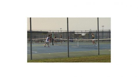 Belvidere North Girls Tennis Team Hussles,Hits and Never Quits.